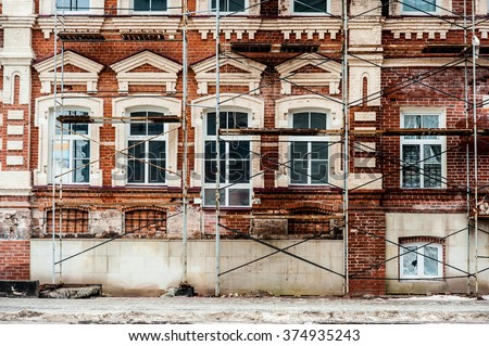 Restoration of old building  with white windows and red blocks