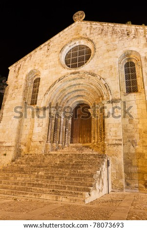 restored entrance and facade of Santiago Church of Coimbra at night, Portugal