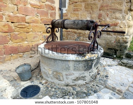 Restored medieval well in a French village