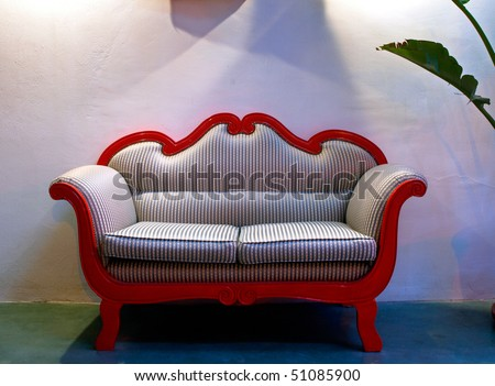 restored vintage sofa in a loft - stock photo