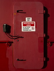 Restricted area red door. Do not enter. Authorized personnel only. Crew only.