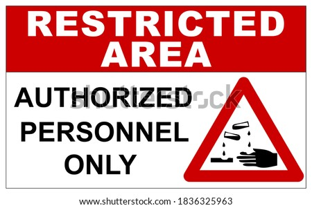 Restricted area sign with corrosive substances warning Stock photo ©