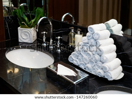 Restroom in hotel or restaurant, focus on towels - stock photo