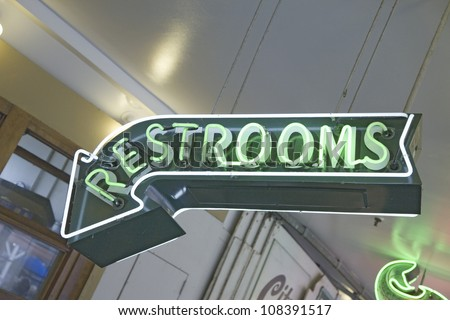 Restroom neon sign in Pike Place Fish Market, Seattle, Washington
