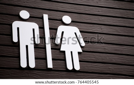 Restroom sign on a toilet door,on wood background.Toilet sign - Restroom Concept - black tone.WC / Toilet icons set. Men and women WC signs for restroom. #764405545