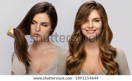 Result of makeover. Young woman happy with her beautiful hair after dyeing and styling in a professional salon. Photo stock ©