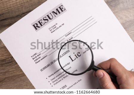 Resume close-up. The concept of false information about yourself when applying for a job, when writing a resume. Lies and deceit concept