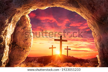 Resurrection Concept - Empty Tomb With Three Crosses On Hill At Sunrise