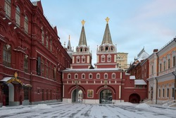 Resurrection gates of Kitay-gorod on an early winter morning. Double passage gates of the Kitaygorodskaya wall, located between the building of the City Duma and the State Historical Museum