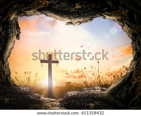 Resurrection of Jesus Christ concept: Tomb empty with cross at sunrise.