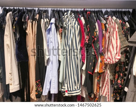 Retail clothes Retail clothes ,shoes store clearance. Garment shop with various bright youth casual wear at discount price.