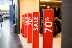 Retail Image Of A Sale Sign In A Clothing Store Window.Retail Image Of A Final Sale Sign In A Clothing Store.shopping and discount concept.