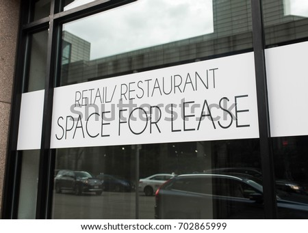 Retail/Restaurant Space for Lease Sign in urban environment. Commercial property in major city.
