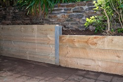 Retaining Wall, built with pressure treated Structural Pine, terraced garden beds.
