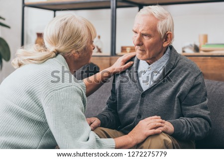 retired couple holding hands and looking at each other at home  Сток-фото ©