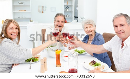 Retired friends toasting together at home