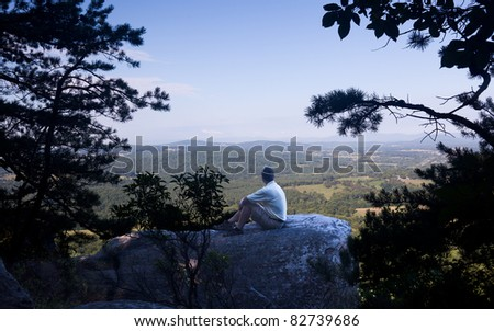 Retired hiker on top of Bull Mountain in Virginia overlooking the valley towards the Blue Ridge and Shenandoah