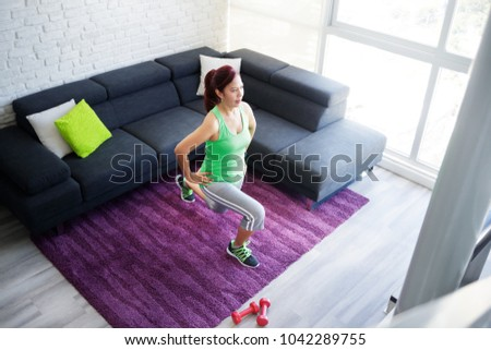 Retired old person, fitness and sports. Elderly latina woman working out at home. Active senior lady doing exercise and sport practice. Recreation, lifestyle, recreational activity #1042289755