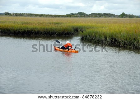 retired senior citizen kayaking on the st johns river near st augustine florida