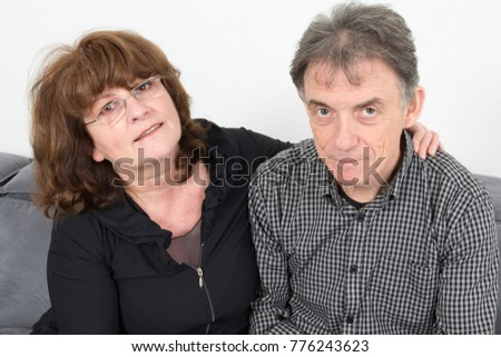 retired senior couple sit on love on the living room couch #776243623