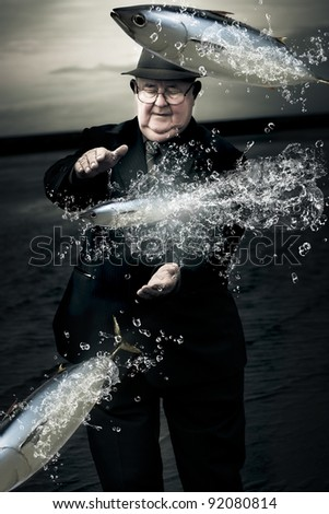 Retired Senior Man Wearing Suit And Tie Standing By A River Trying To Catch Jumping Tuna Fish In A Metaphor For The One That Got Away