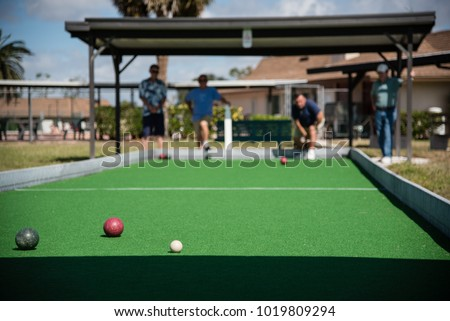 Retired seniors playing bocce ball at a retirement community in Florida