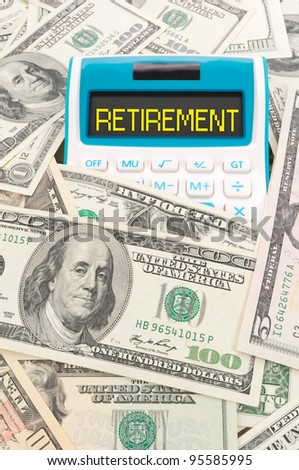 Retirement concept, word on calculator with hundreds of American notes