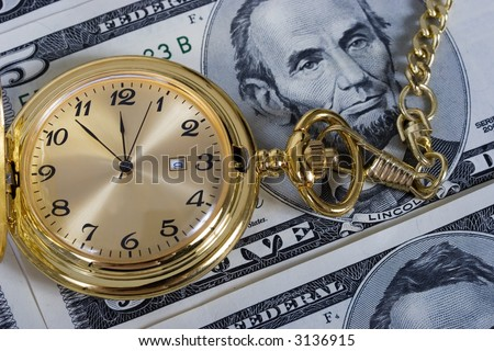 Retirement gold watch on a five dollar bill background
