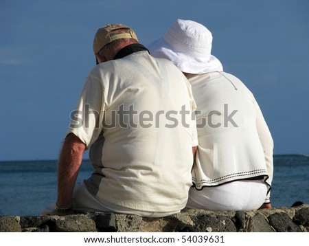 Retirement Image of a Senior Couple on Vacation By the Sea