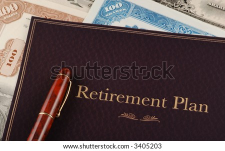 Retirement Plan on top of vintage stock certificates