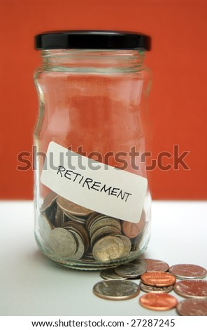 Retirement savings in glass jar with quarters, dimes, nickels, and pennies