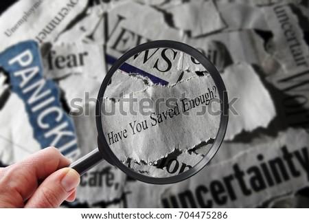 Retirement savings news headline, and magnifying glass #704475286