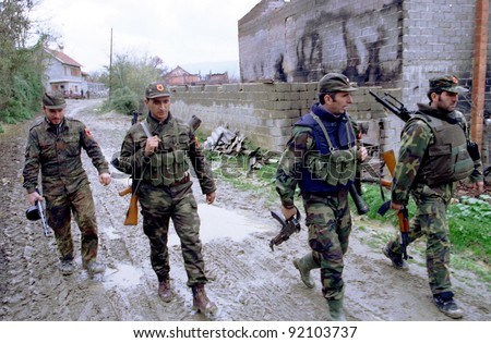RETMILJE, KOSOVO,  07 NOVEMBER 1998 --- Soldiers of the Kosovo Liberation Army (KLA) on patrol  in the Drenica Triangle.  (C) Photo Credit: Mark H. Milstein/ Northfoto
