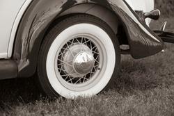 Reto style automobile wheel closeup in sepia monochrome.
