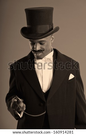 Retro afro american dickens scrooge man with mustache. Wearing black hat. Looking at his timepiece.