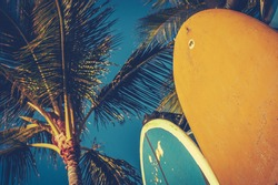 Retro Aged Style Photo Of Surf Boards And Palm Trees