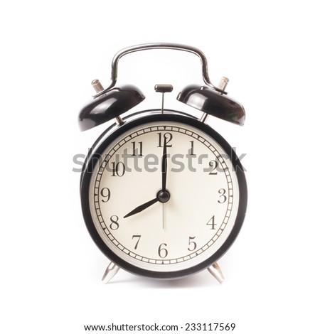 Retro alarm clock on isolated white background