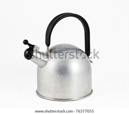 retro aluminium teapot with black plastic handle and clipping path - stock photo