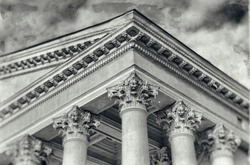 Retro. Ancient Temple. Old photo. Classic Architecture. Courthouse. Ornate columns and a pediment in a style of classical architecture. Legal and order. Classic style. Justice. Law. Vintage.