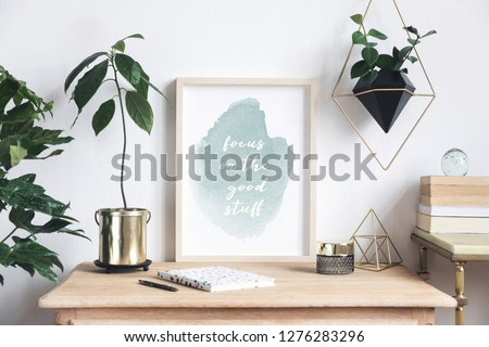 Retro and minimalistic interior with mock up photo frame on the vintage shelf, hanging plant in design pot, avocado plant, books, gold pyramid and accessories. Shelfie concept. #1276283296