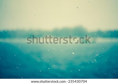 Retro art of sea and beach during raining. Defocus image.