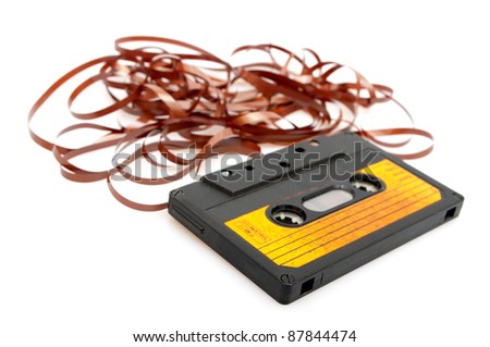 Retro Audio Cassette Tape With Pulled Out Tape on White Background - Shallow Depth of Field