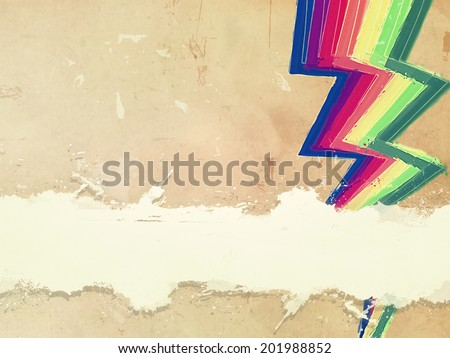 retro background with drawn rainbow zigzag lines and text space over old paper