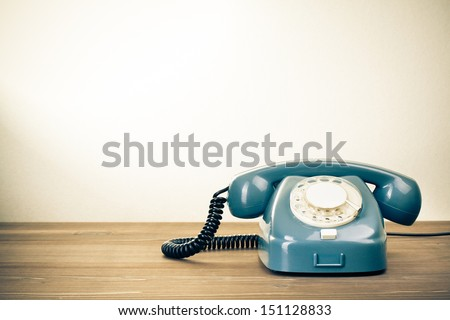 Retro background with rotary telephone on wood table #151128833