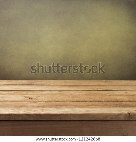 Retro background with wooden table and grunge wall