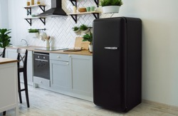 Retro black fridge in gray wooden kitchen