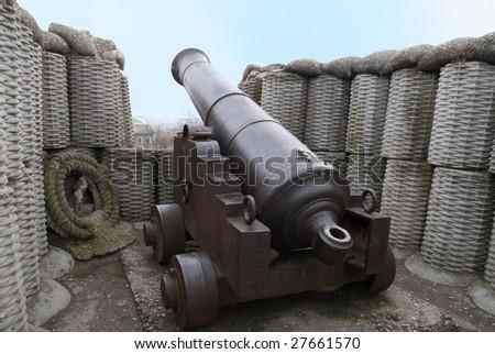 Retro black melal gun in the fortification