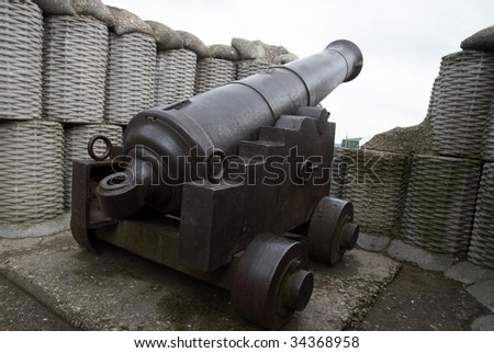 Retro black metal gun in the fortification