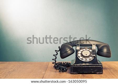retro black telephone on wooden ...