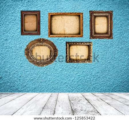 Retro blue room with empty frames